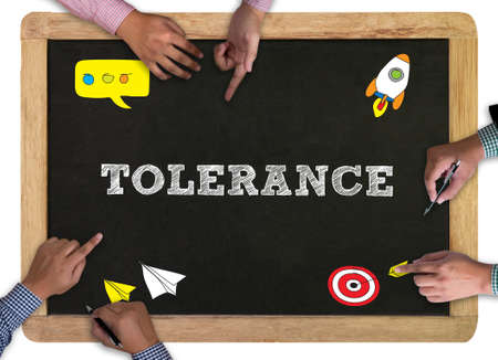 tolerance: vintage blackboard with wooden frame isolated on white background. chalkboard with TOLERANCE CONCEPT