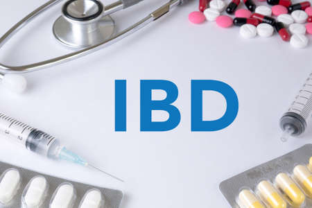 colitis: IBD - Inflammatory Bowel Disease. Medical Concept Medication Text, On Background of Medicaments Composition, Stethoscope, mix therapy drugs doctor flu antibiotic pharmacy medicine medical Stock Photo