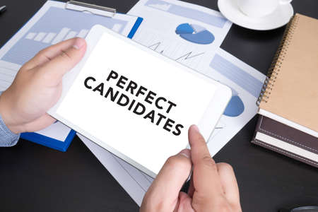 doing business: PERFECT CANDIDATES CONCEPT  Modern people doing business, graphs and charts and touch-pad
