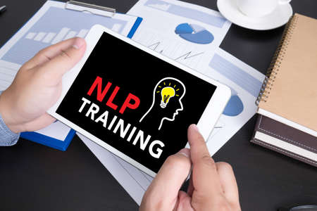 doing business: NLP TRAINING CONCEPT Modern people doing business, graphs and charts and touch-pad