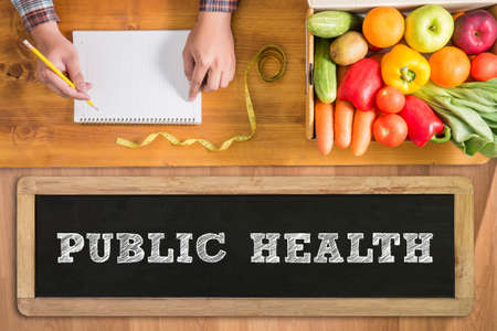 public health: PUBLIC HEALTH CONCEPT    fresh vegetables and  on a wooden table