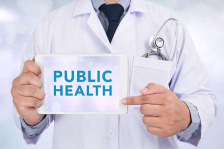 public health: PUBLIC HEALTH CONCEPT   Doctor holding  digital tablet