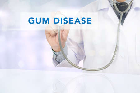 pathologic: GUM DISEASE CONCEPT Medicine doctor hand working on virtual screen Stock Photo