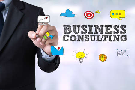 BUSINESS CONSULTING CONCEPT Businessman drawing Landing Page on blurred abstract background Foto de archivo