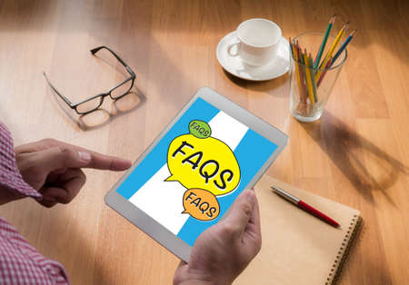 frequently asked questions: Frequently Asked Questions Faq Feedback  Concept touch digital tablet, coffee Stock Photo
