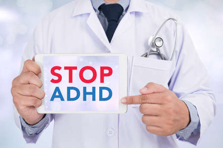 adhd: STOP ADHD Doctor holding  digital tablet