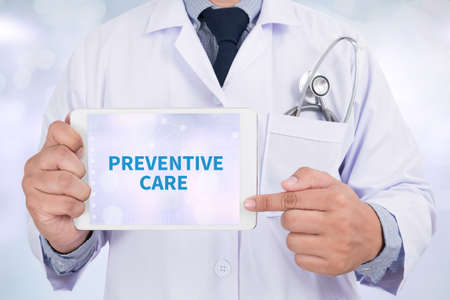 preventive: PREVENTIVE CARE  Doctor holding  digital tablet Stock Photo