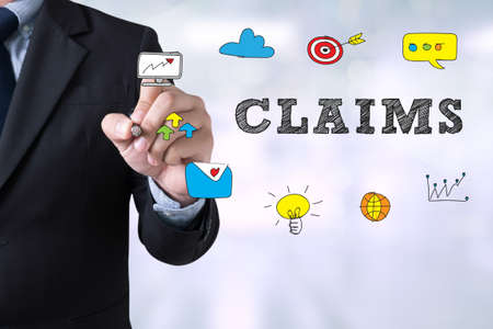 claims: CLAIMS CONCEPT Businessman drawing Landing Page on blurred abstract background Stock Photo
