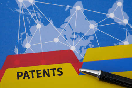 patents: PATENTS Office folder color on Desktop on table and business strategy