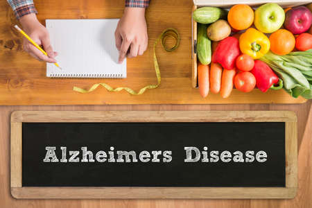 alzheimers: Alzheimers Disease concept fresh vegetables and  on a wooden table