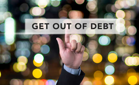 get out: Get Out of Debt concept Business man with hand pressing a button on blurred abstract background