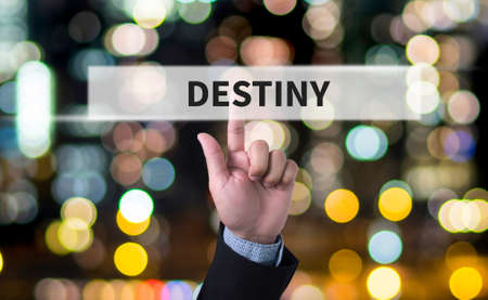 destiny: DESTINY CONCEPT Business man with hand pressing a button on blurred abstract background