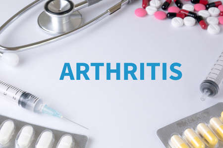 spondylitis: ARTHRITIS Text, On Background of Medicaments Composition, Stethoscope, mix therapy drugs doctor flu antibiotic pharmacy medicine medical Stock Photo