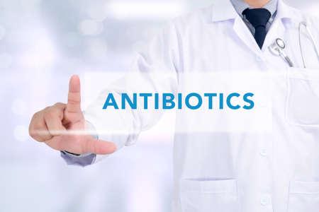 antibiotics: ANTIBIOTICS CONCEPT Medicine doctor working with computer interface as medical