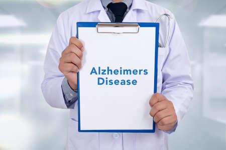 amnesia: Alzheimers Disease concept Portrait of a doctor writing a prescription Stock Photo