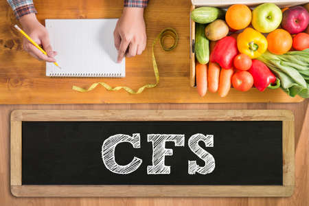 depletion: CFS fresh vegetables and  on a wooden table