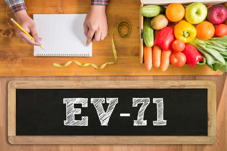 enteric: EV-71 fresh vegetables and  on a wooden table