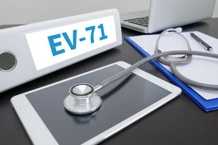 polymorphism: EV-71 folder on Desktop on table. Stock Photo