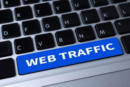 web traffic: WEB TRAFFIC a message on keyboard Stock Photo