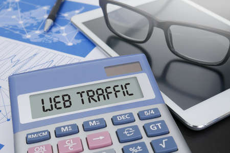 web traffic: WEB TRAFFIC Calculator  on table with Office Supplies.
