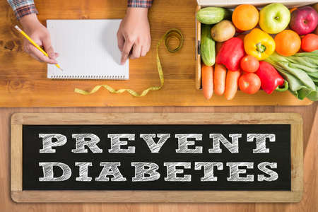 prevent: PREVENT DIABETES with fresh vegetables and  on a wooden table,