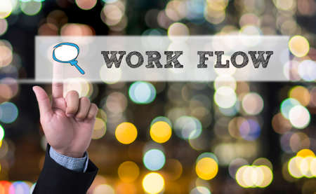 reciprocity: WORK FLOW Business man with hand pressing a button on blurred abstract background