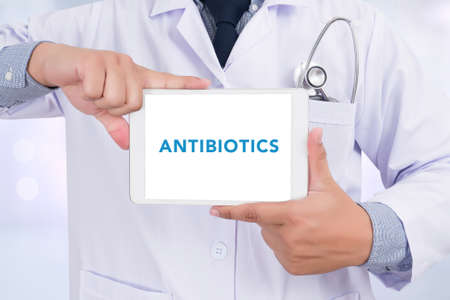 doctor tablet: ANTIBIOTICS CONCEPT Doctor holding  digital tablet