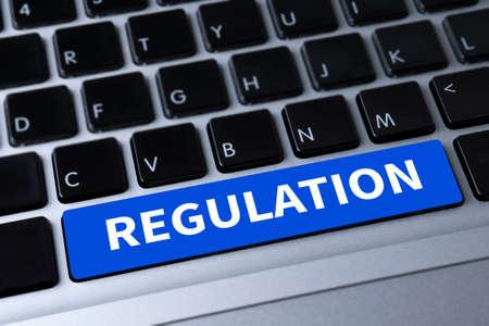 regulation: REGULATION a message on keyboard Stock Photo