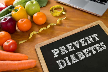 prevent: PREVENT DIABETES concept, fruit and tape measure on a wooden table, top view,