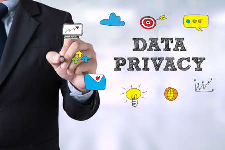 DATA PRIVACY Businessman drawing Landing Page on blurred abstract background