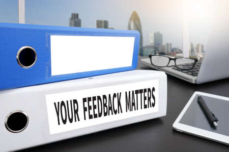 solicitation: YOUR FEEDBACK MATTERS Office folder on Desktop on table with Office Supplies.