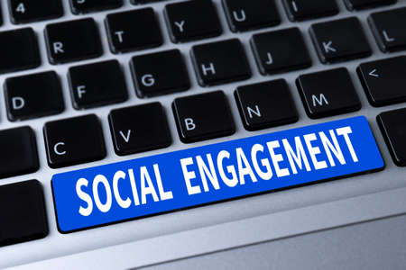 participatory: SOCIAL ENGAGEMENT a message on keyboard Stock Photo