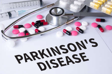 parkinson's disease: PARKINSONS DISEASE Background of Medicaments Composition, Stethoscope, mix therapy drugs doctor flu antibiotic pharmacy medicine medical Stock Photo