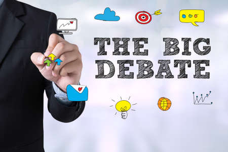 controversy: THE BIG DEBATE Businessman drawing Landing Page on blurred abstract background Stock Photo