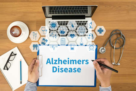 alzheimers: Alzheimers Disease concept Top view, Doctor writing medical records on a clipboard, medical equipment