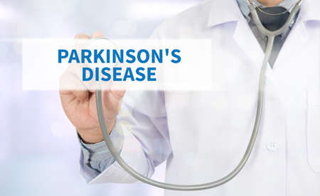 PARKINSONS DISEASE Medicine doctor hand working on virtual screen