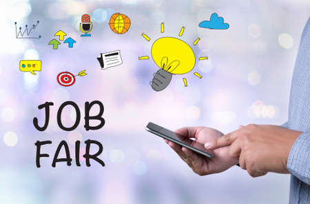 seeking assistance: JOB FAIR person holding a smartphone on blurred cityscape background
