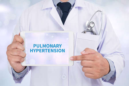pulmonary: PULMONARY HYPERTENSION Doctor holding  digital tablet Stock Photo