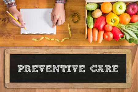 preventative: PREVENTIVE CARE  fresh vegetables and  on a wooden table