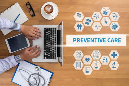 preventive: PREVENTIVE CARE  Professional doctor use computer and medical equipment all around, desktop top view, coffee Stock Photo