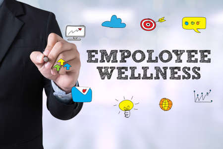 EMPOLOYEE WELLNESS Businessman drawing Landing Page on blurred abstract background