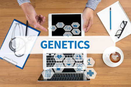 genomes: GENETICS Doctor touch digital tablet, desktop with medical equipment on background, top view, coffee