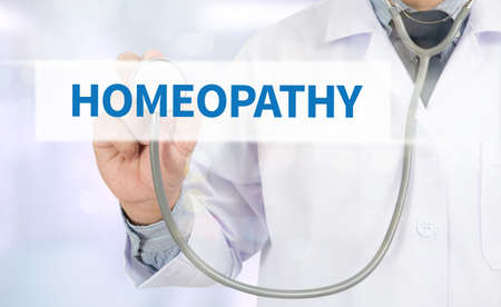 diagnosed: HOMEOPATHY Medicine doctor hand working on virtual screen