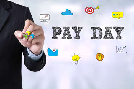 medium group of objects: PAY DAY Businessman drawing Landing Page on blurred abstract background Stock Photo
