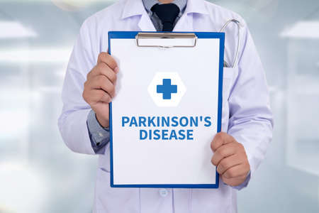 motor neuron: PARKINSONS DISEASE Portrait of a doctor writing a prescription