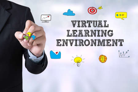 assessment system: VIRTUAL LEARNING ENVIRONMENT Businessman drawing Landing Page on blurred abstract background