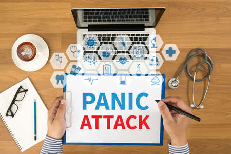panic attack: PANIC ATTACK Top view, Doctor writing medical records on a clipboard, medical equipment Stock Photo