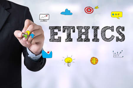 ethics: ETHICS Businessman drawing Landing Page on blurred abstract background Stock Photo