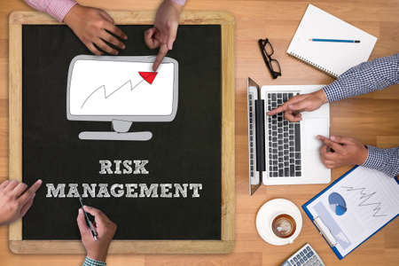 online safety: RISK MANAGEMENT Concept Businessman working at office desk and using computer and objects on the right, coffee,  top view,