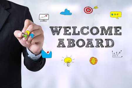 aboard: WELCOME ABOARD Businessman drawing Landing Page on blurred abstract background